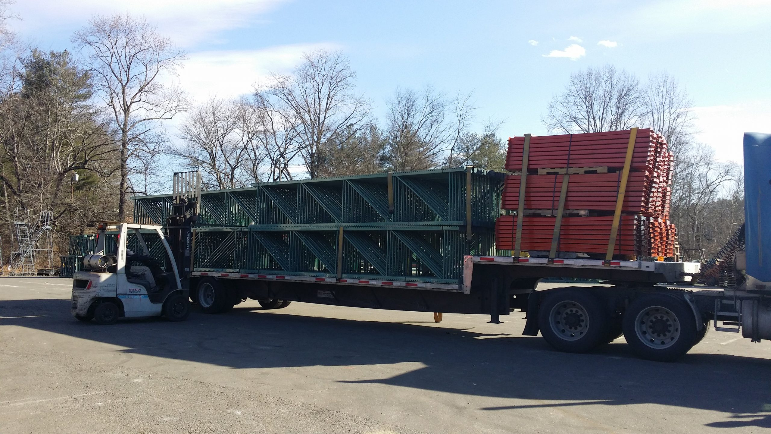Flatbed truck loaded with teardrop uprights and teardrop beams